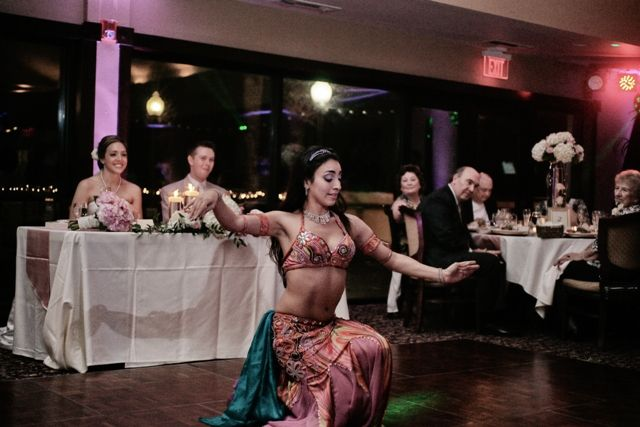 Surprise belly dance for the bride and groom